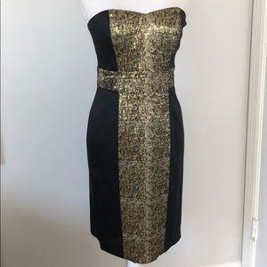 Strapless black dress with metallic details